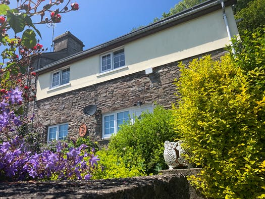 gower view apartment. stone and cream walls purple flowers and greenery