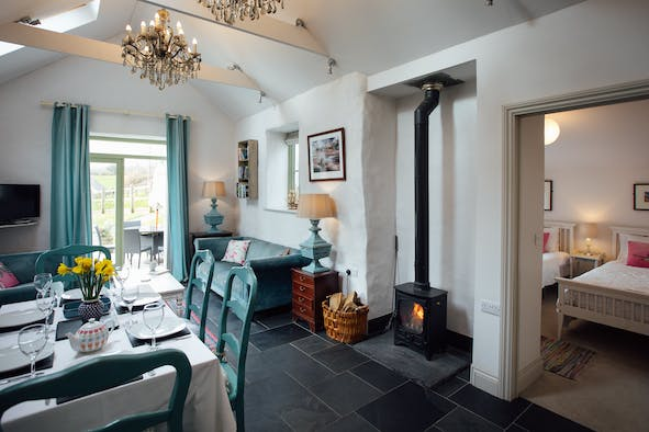 Lounge diner with woodburner, dining table and chairs, sofa, french doors
