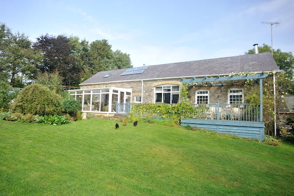 Outside of Gilfach Barn with chickens on the lawn