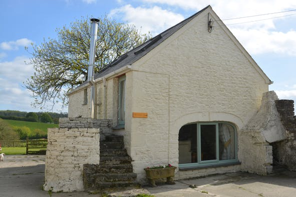 The outside of Brynbanc Coach House with steps and large window