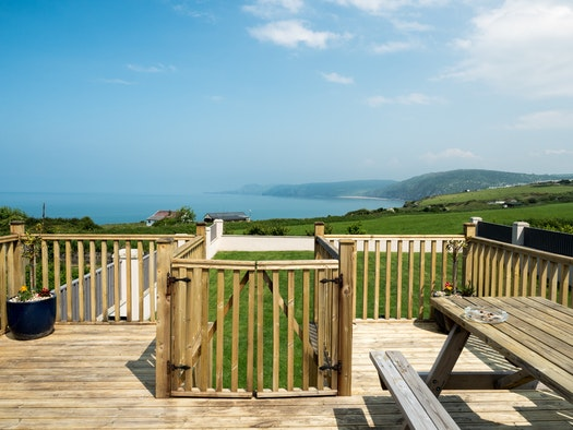 Views to the sea from the decking at the back of Porthceri