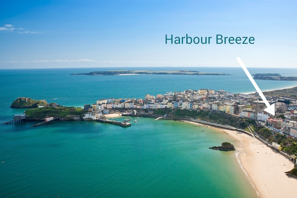 View of Tenby harbour with arrow showing location of Harbour breeze apartment
