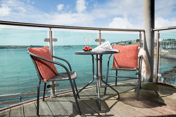Table and chairs on the balcony overlooking Milford Haven waterway