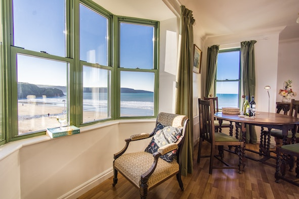 Looking out of sitting room windows over beach and sea