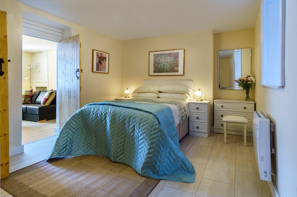 Double bed with chest of drawers and bedside cabinets and lamps