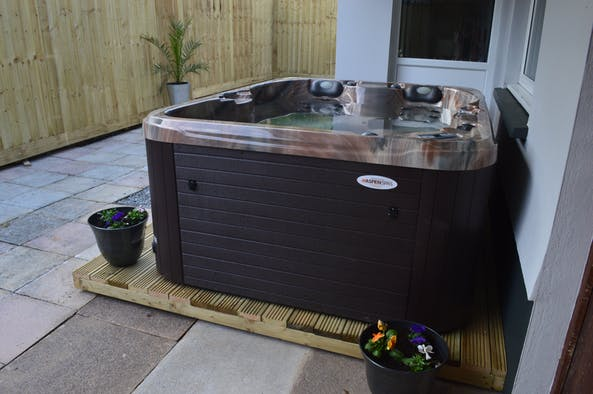 Hot tub outside with paving around it