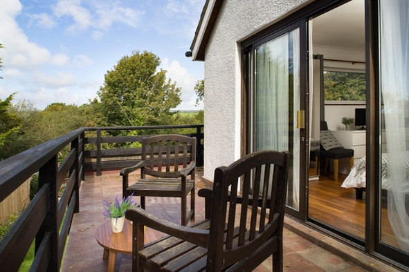 Table and chairs on veranda outside the bedroom