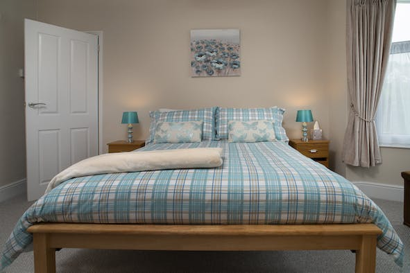 Bedroom with double bed, two bedside cabinets and lamps