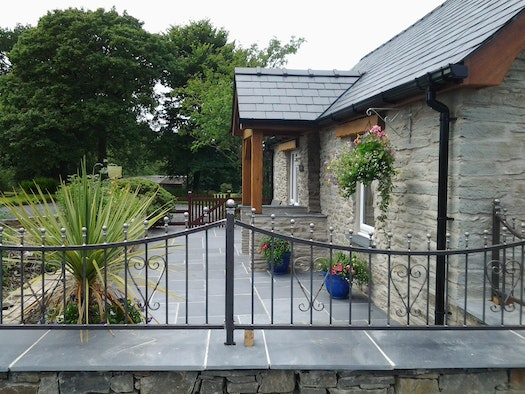 Gwaun Cottage exterior showing front entrance, porch and railings