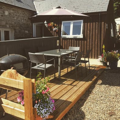 Patio and deck, table and chairs, parasol, bbq