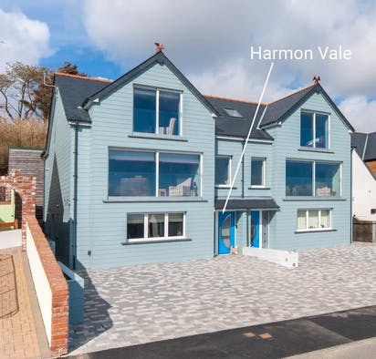 Exterior of Harmon Vale with paved parking area in front and level access