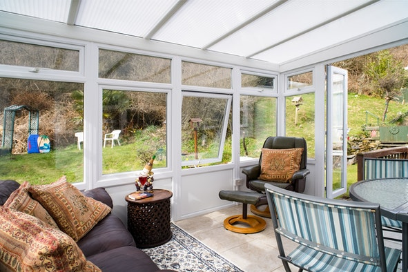Sofa,chair and table and chairs in Barlaine's conservatory