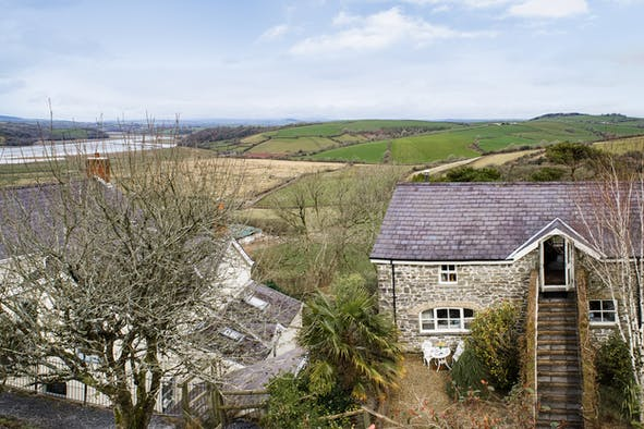 The outside of Taf Cottage looking down the estuary