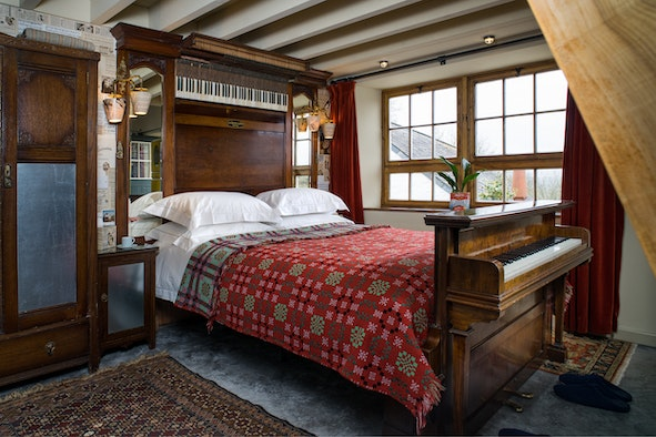 King size bed made from 2 pianos