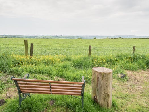 Garden bench with views over open countryside