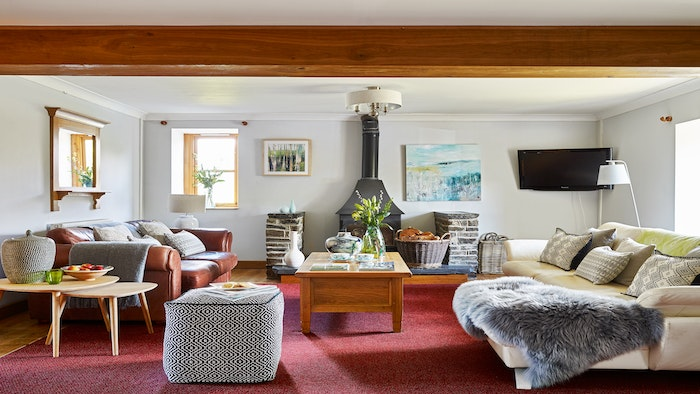 Sofas, cushions and blankets and coffee table and TV