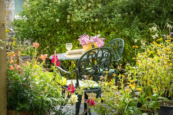 Garden table and chairs with garden flowers in Glanafon Bach
