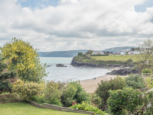The view the garden at The Beach House to Aberporth beaches