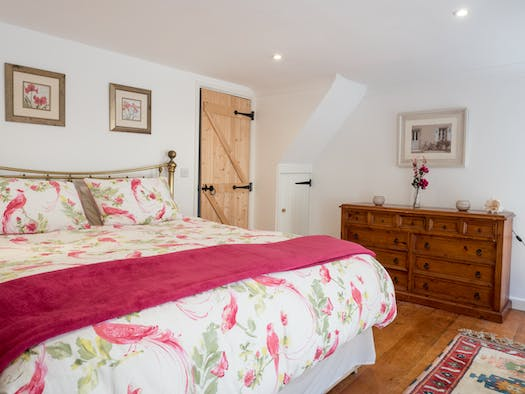 Bedroom with king size bed, chest of drawers