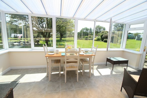 Conservatory in Dothan with dining table and chairs, views into the garden