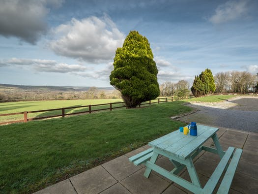 Patio area at Blaenbetws with picnic table and far reaching views