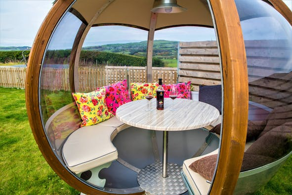 Rotating sphere with table and chairs in the garden