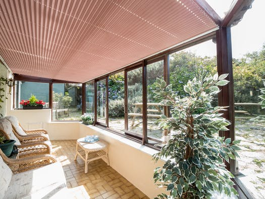 Sofas, armchairs and view of the garden through large windows