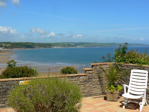 5 Captains Walk walled terrace with superb views across the beach and sea