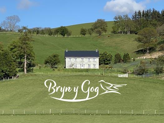 Bryn Y Gog from a distance across fields
