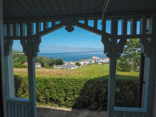 View over New Quay towards the sea from the porch at Ringwood