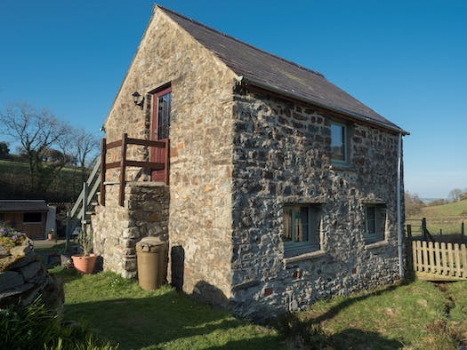 The Coach House, a stone building with external stairs
