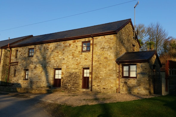 Exterior of Esgair Llyn, a ground floor apartment in a stone building
