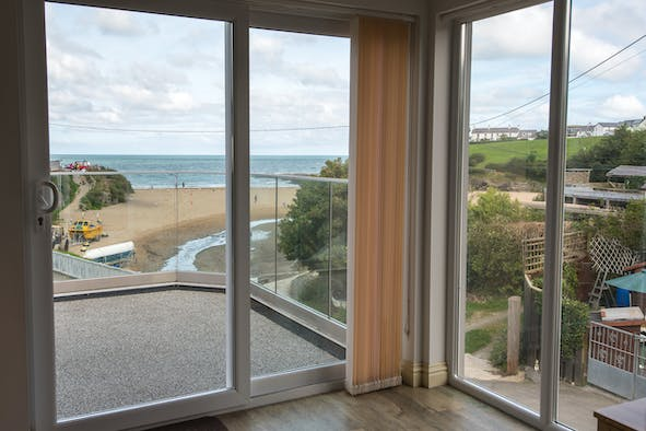 The view from Estyn y Mor through patio doors to the beach