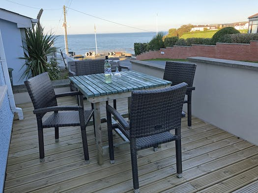 Decking in front of Gwalia Stores with table and chairs, sea views