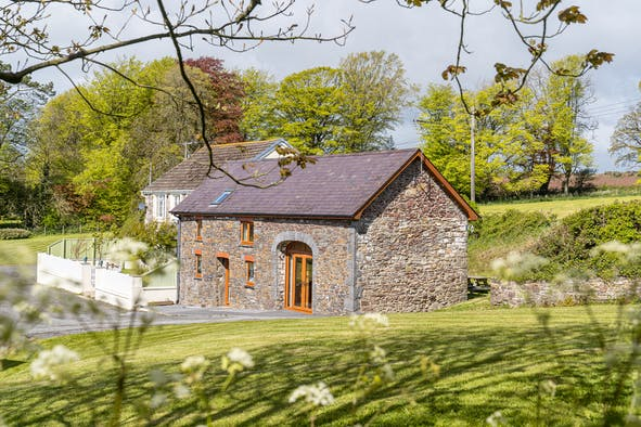 The Cart House. Stone barn conversion with brown framed windows