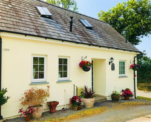 Penally, front of cottage with hanging baskets