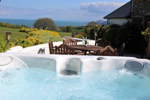 Hot tub with view over countryside towards the sea
