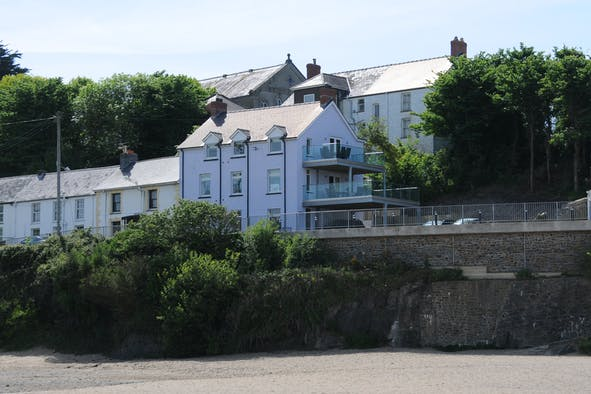 The Old Post Office from the sandy beach