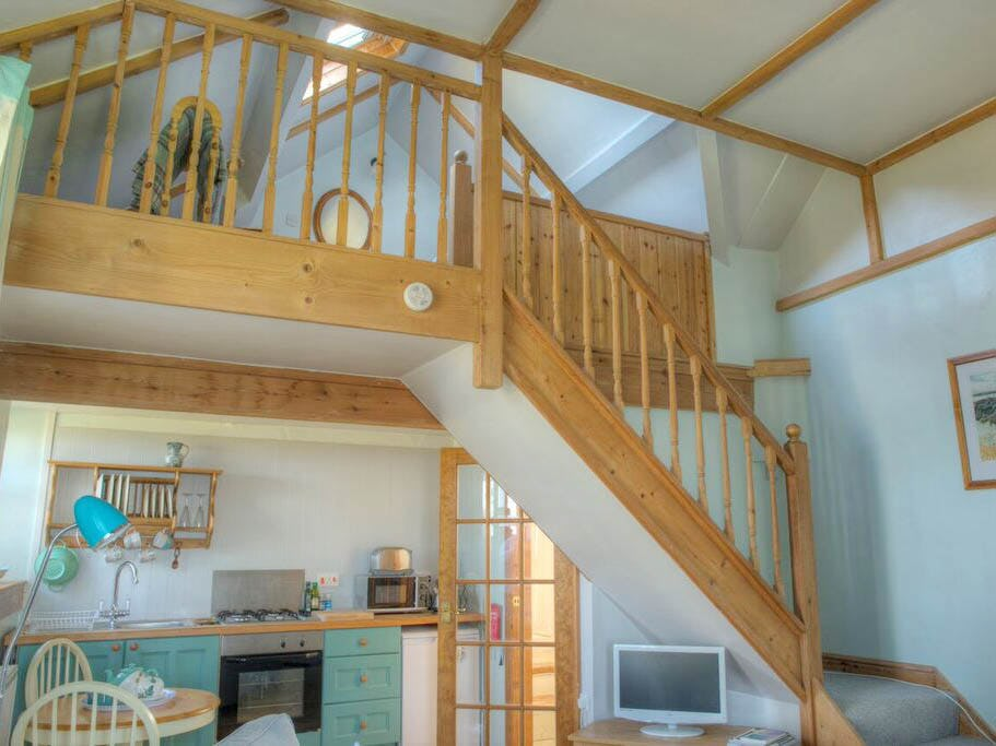 The granary holiday cottages with sea views near tresaith cardigan bay wales sleeps 2 plus cot - Open mezzanine ...