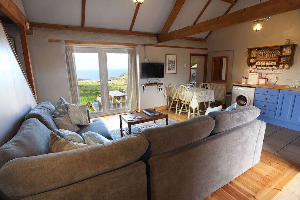 The Hayloft Sitting Room Corner Sofa Kitchen Dining Area And Patio Doors With