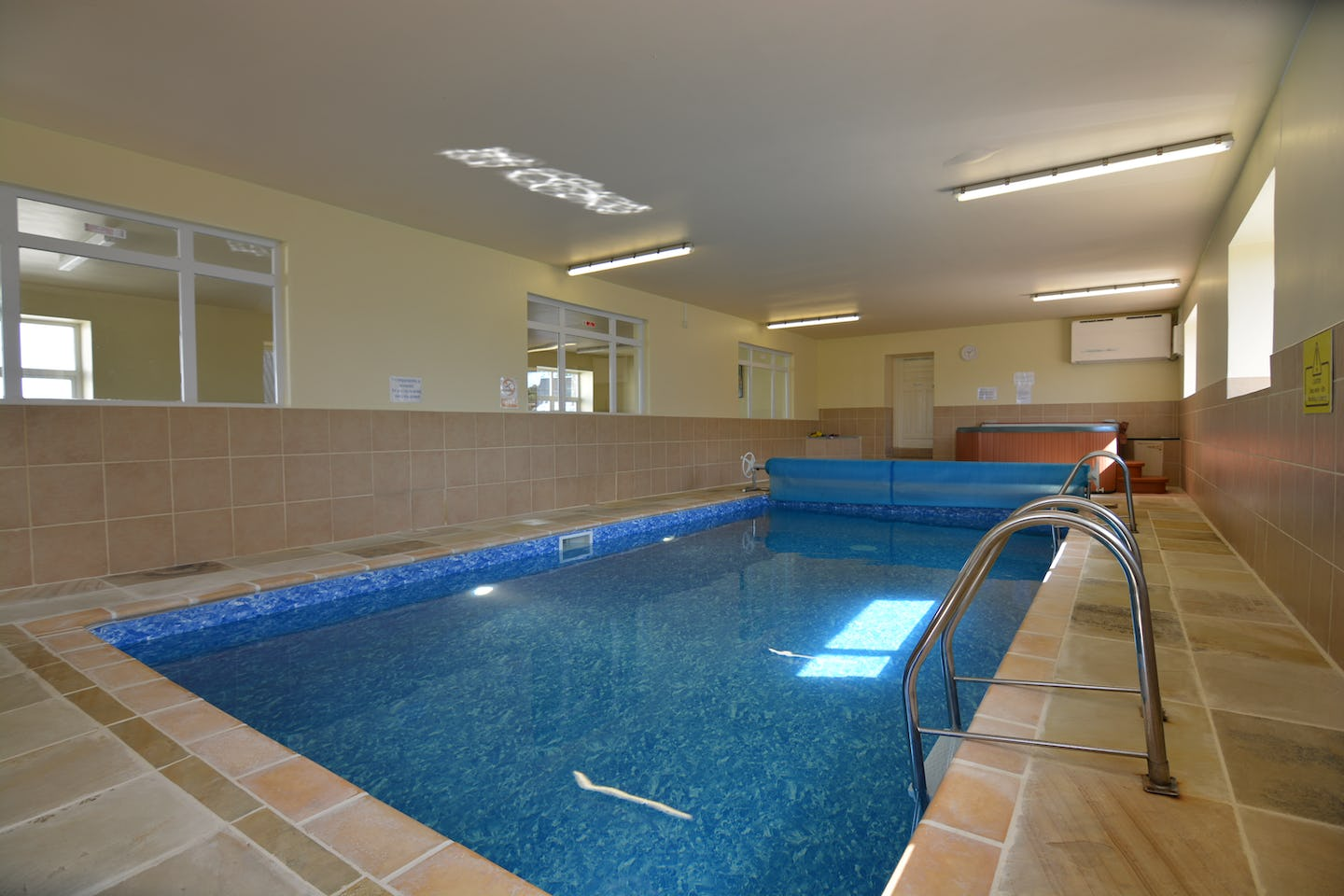 Nyth y wennol luxury holiday cottage with a shared swimming pool on penwaun farm tanglwst for Holiday cottages in wales with swimming pools