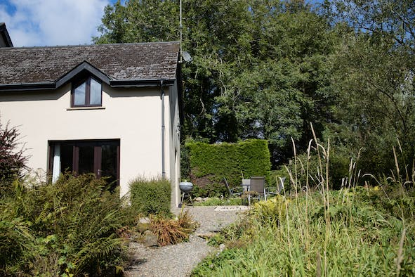 Outside Ramsey Cottage, gravel path, garden, french doors