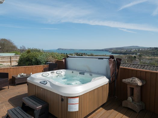 Hot tub at Seaview Cottage on patio with sea views