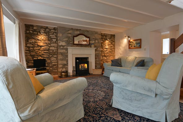 Cosy cottage sitting room with log burner